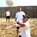 The Isle of Palms Council serves it to the IOP Municipal team at the Windjammer volleyball court.