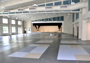 The multipurpose room can be divided in two to operate as a cafeteria and PE room, as well as an auditorium. Large windows are a dominant feature in the school, letting in natural light throughout. (Photo by Barb Bergwerf)