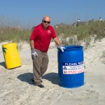 Donnie Pitts deploys IOPs recycling bins along front beach. (Photo by Steve Rosamilia)
