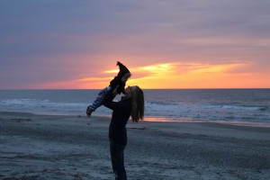 Emily Watson showing her son the Dewees beach.