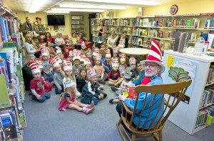 Perkis reading to local children at the Poe Library.