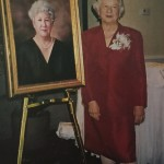 Mayor Bunch with her formal portrait that hangs in IOP's council chambers.