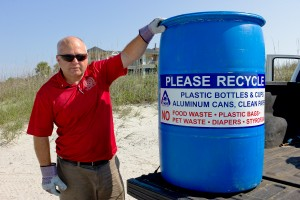 MAY Donnie Pitts deploys IOPs recycling bins along front beach