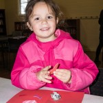 Caitlin Moroney makes a Valentine's Day card at Cupid's Card Shop