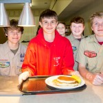 Order up! Left to right, Boy Scout Troop 502 members Mason Suggs, Daniel Killough, Bennett Huff, Will Frame and Christian Huggins stand ready to serve at the Shrove Tuesday pancake supper at the First United Methodist Church on Isle of Palms.