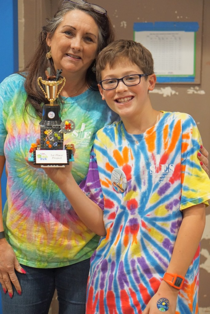 Joey Virgilio and Mrs. Moye with their first place trophy for their invention.
