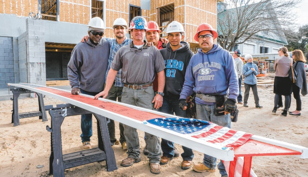 Members of Hill Construction prepare the beam for its placement.