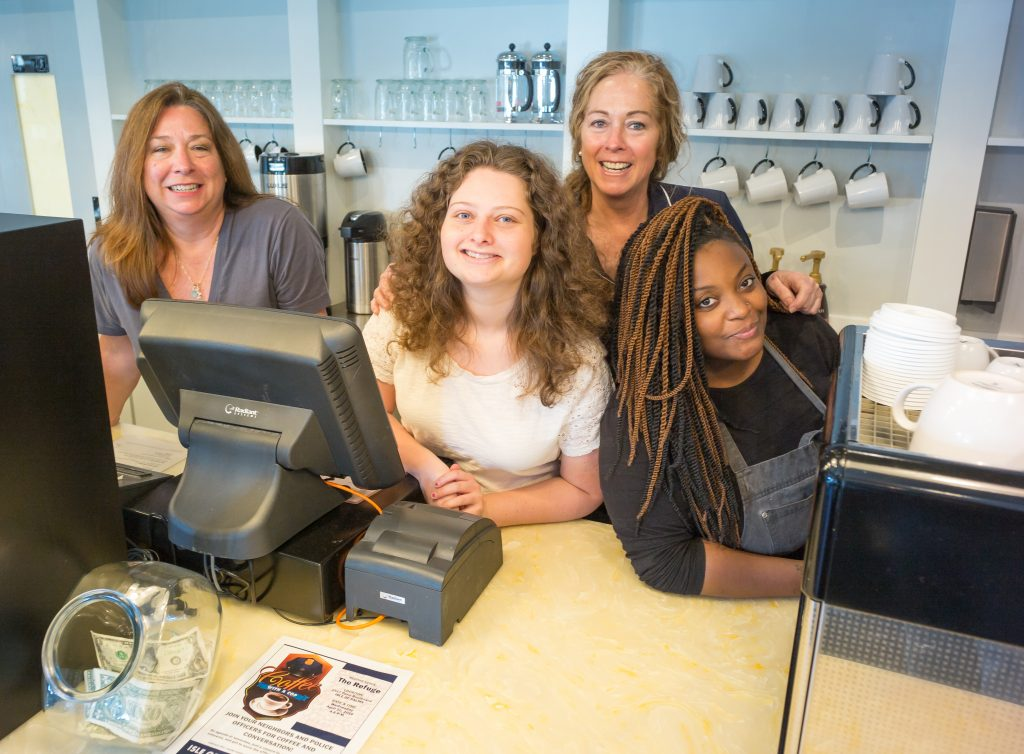 Patty Lamond, Amelia Turkewitz, Jocelyn Lamond, and Labre Bucker hang at the Refuge's cafe