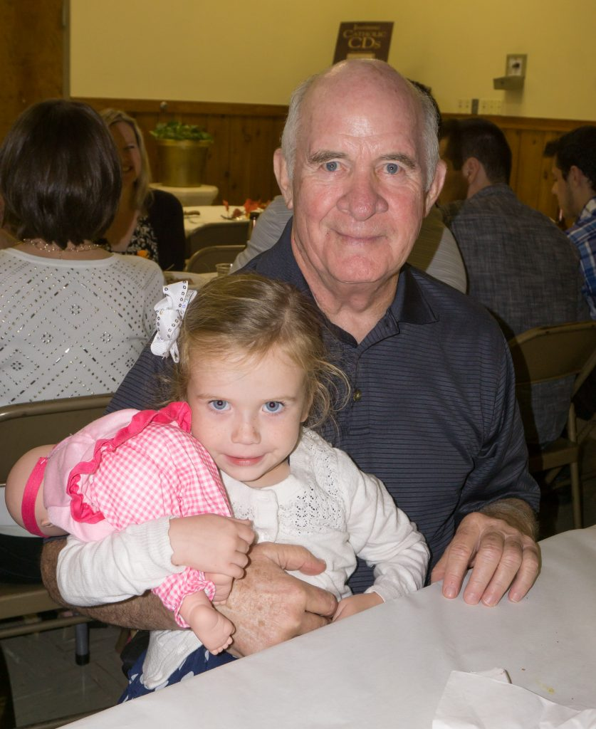 Emily Mahnken and her grandfather Richard Clark at the Stella Maris Oktoberfest Celebration.